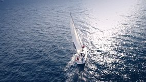 Yacht sailing on opened sea. Sailing boat. Yacht from drone. Yachting video. Yacht from above. Sailboat from drone. Sailing video. Yachting at windy day. Yacht. Sailboat.