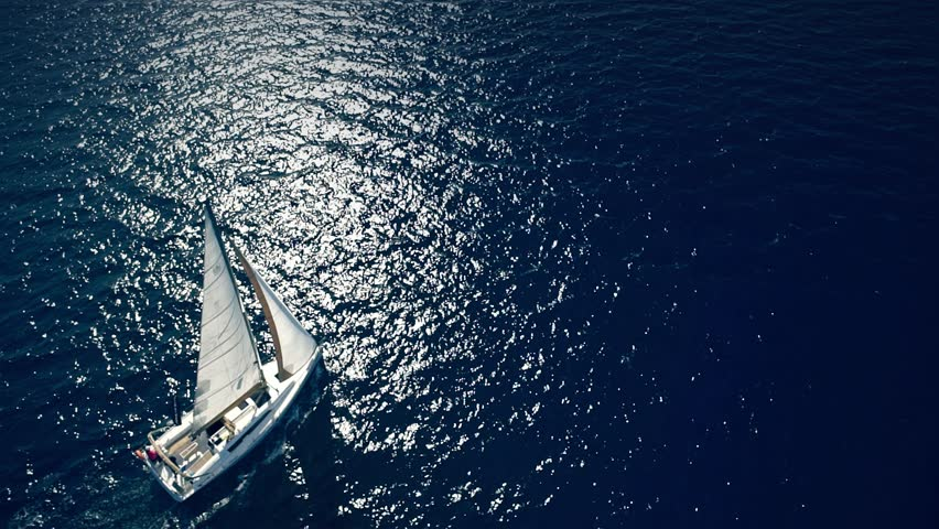 Yacht sailing on opened sea. Sailing boat. Yacht from drone. Yachting video. Yacht from above. Sailboat from drone. Sailing video. Yachting at windy day. Yacht. Sailboat. | Shutterstock HD Video #16596547