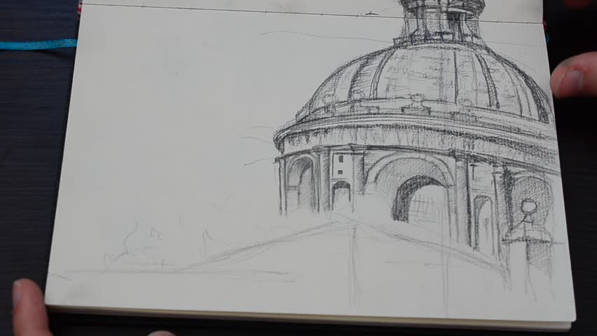 We thumb through sketchbook with drawings.   Shutterstock HD Video #16596901