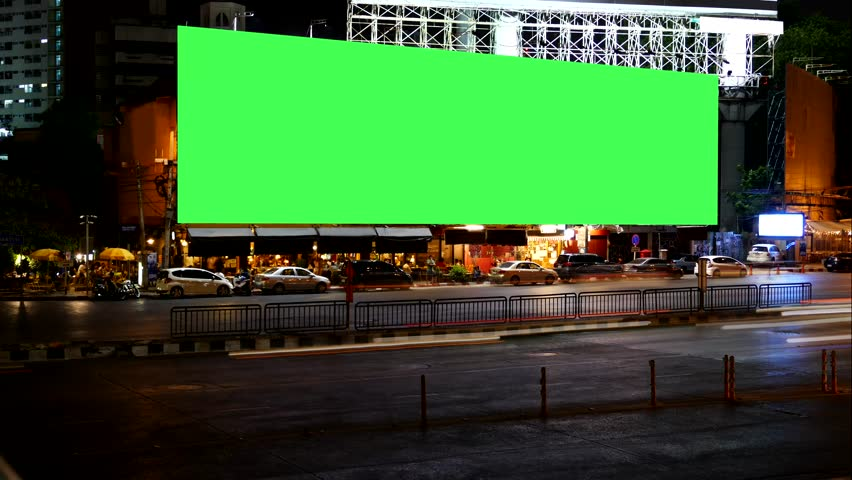 Blank Advertising Billboard green screen beside road with traffic at night, for advertisement, time lapse. #16616137