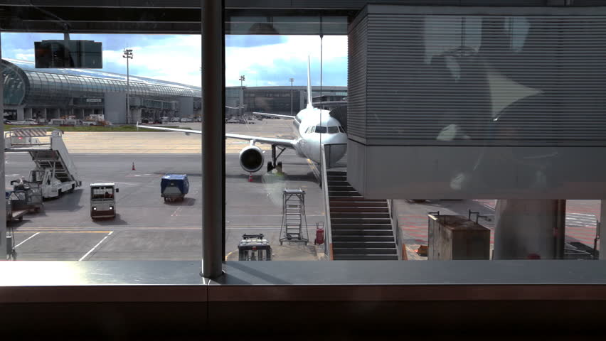 Piece of airport - view from boarding room with reflections.   Shutterstock HD Video #16648861
