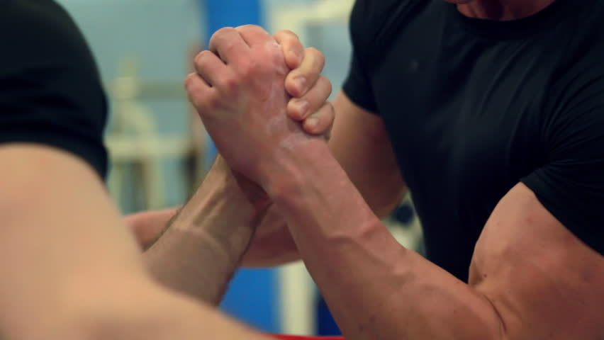Intense struggle at arm-wrestling competition close-up
