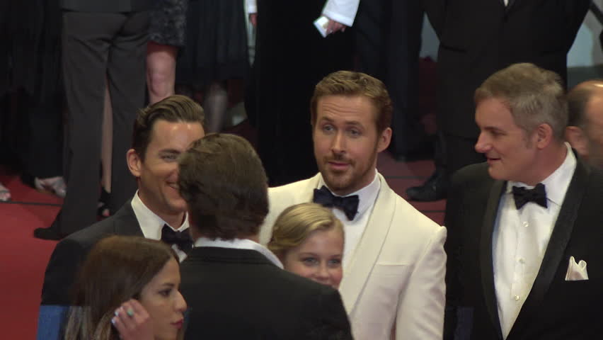 Cannes - May 15: Ryan Gosling in Gucci and the cast of The Nice Guys (Russell Crowe, Matt Bomer in Giorgio Armani, producer Joel Silver and wife, filmmaker Shane Black, Angourie Rice, Murielle Tello) | Shutterstock HD Video #16694356