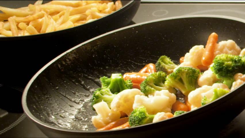 Frying vegetables | Shutterstock HD Video #1670074
