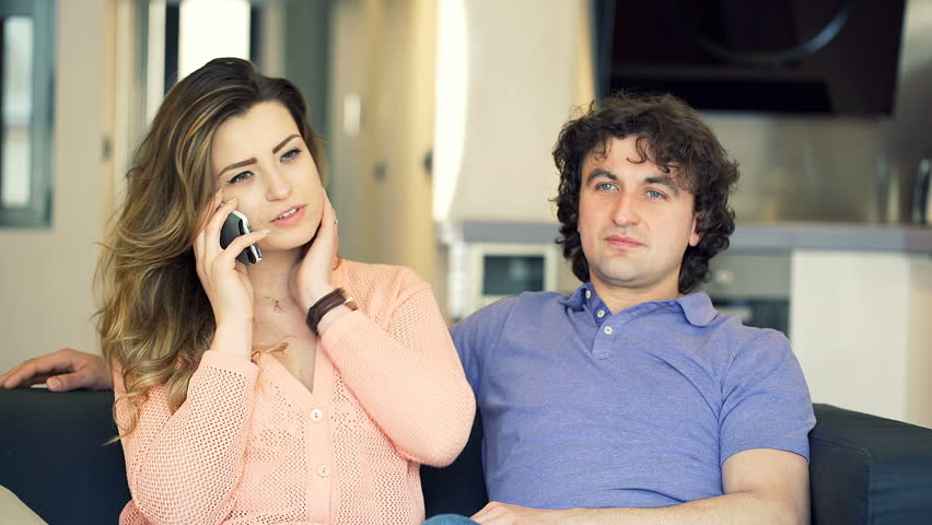 Couple talking on cellphone and receiving good news, steadycam shot  | Shutterstock HD Video #16706644