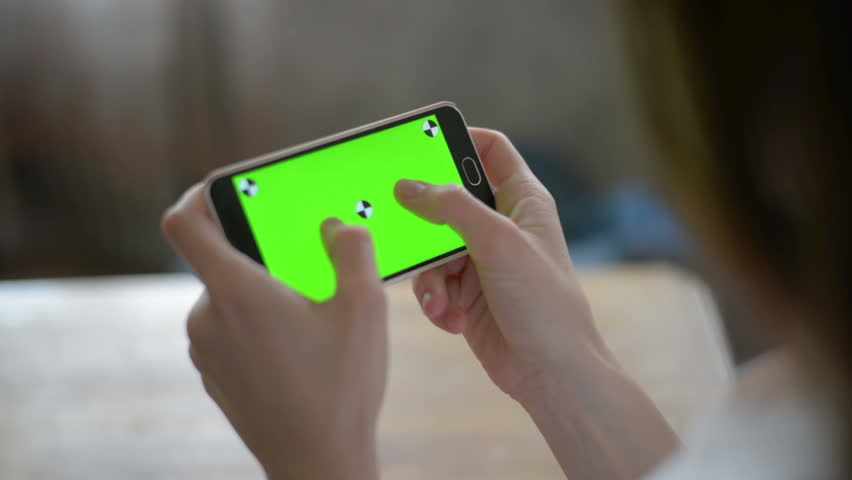 Young Girl is Holding Smartphone with Green Screen at Evening Time. | Shutterstock HD Video #16730560