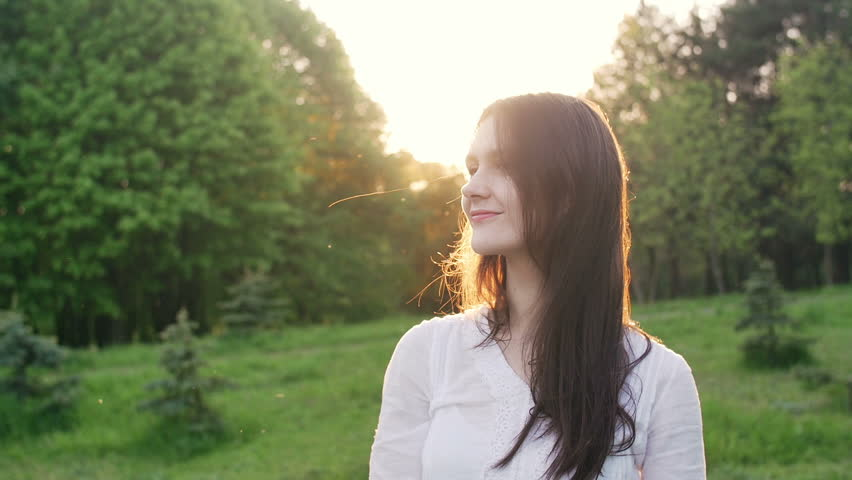 Happy woman in a park or a forest at sunset   Shutterstock HD Video #16770400