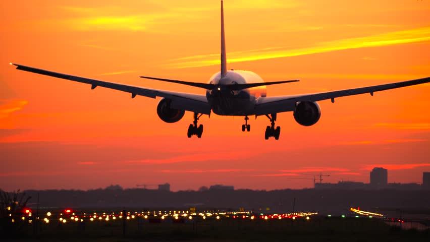 4K Boeing 777 landing at sunrise