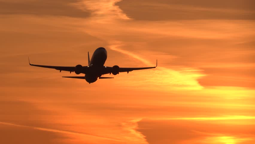 4K Early sunrise airplane takeoff, tracking shot