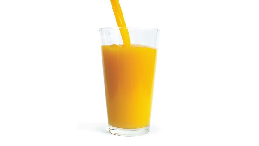 Orange Juice Pours Into Glass