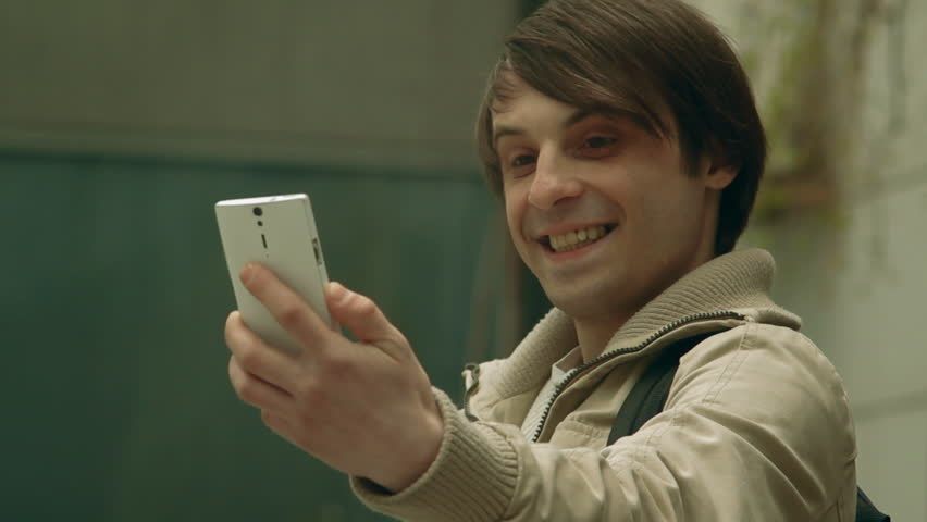 The guy makes selfie phone at the down street | Shutterstock HD Video #16791169