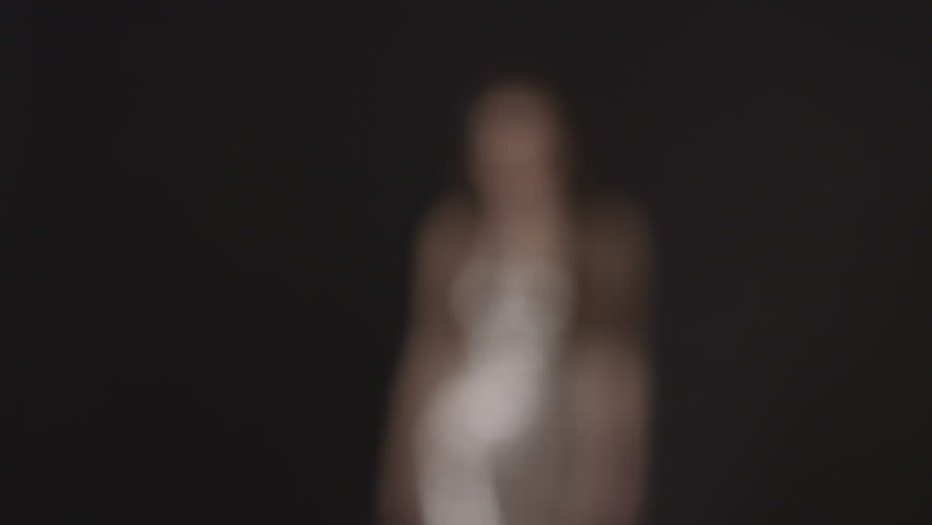 Young woman walks to camera, into focus, puts hands on hips | Shutterstock HD Video #16793320