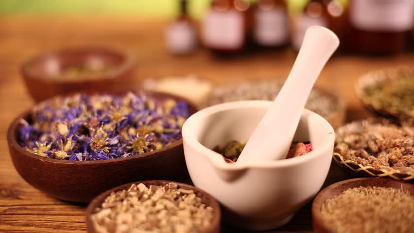 Assorted natural medical herbs and mortar | Shutterstock HD Video #16794217