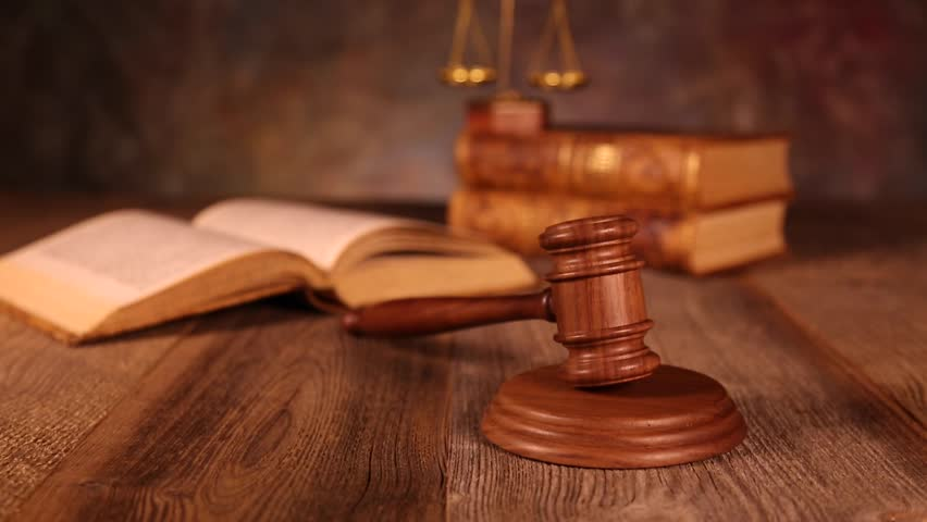 Law, legal code and scales of justice | Shutterstock HD Video #16800400