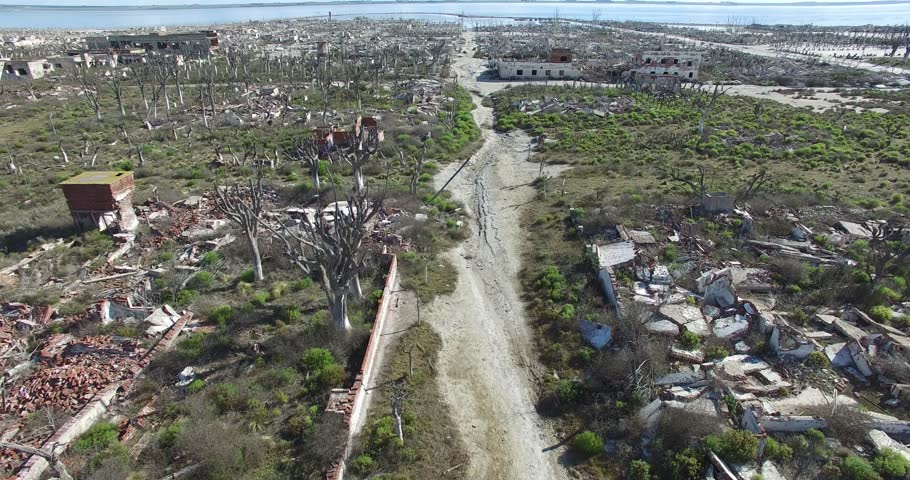 Aerial drone scene of destroyed, demolished, city, neighbourhood, camera flying slowly to the lake. Urban landscape. #16803700