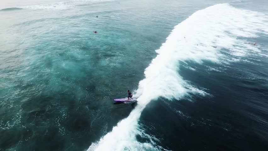 Aerial view of huge ocean waves and surfing in Bali indonesia | Shutterstock HD Video #16813918