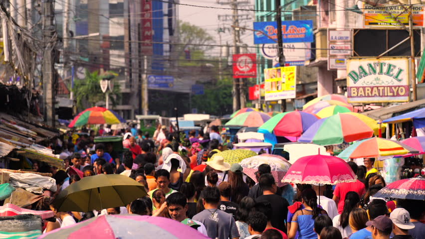 San Fernando - 25 MAR: Penitents making their way through the crowded street market in San Fernando during the Holy Week on 25 March 2016 in Pampanga, Philippines