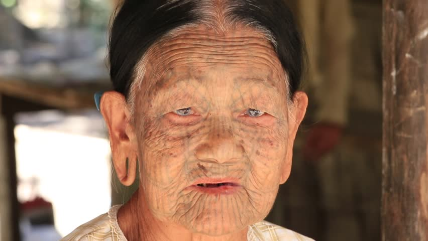 MRAUK-U, MYANMAR - JANUARY 27, 2016: The portrait of Chin woman with spider tattoo. Chin people, also known as the Kukis are a number of Tibeto Burman tribal people. | Shutterstock HD Video #16832068