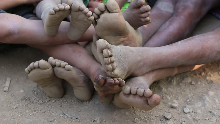 Dirty and ragged feet Burmese children. Mrauk-U, Myanmar. Close up #16832101