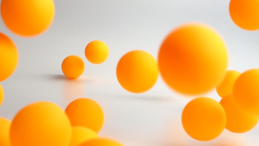 many orange balls falling and bouncing over the white surface slow motion