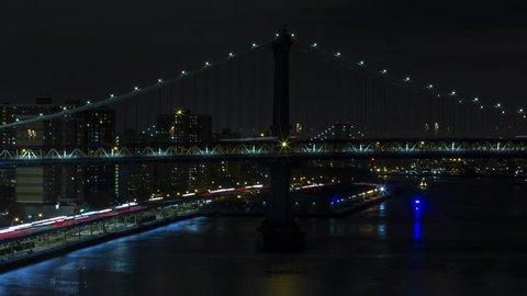 New York, USA - October 03, 2014: Time lapse of Manhattan Bridge at night in Manhattan, New York City, New York, USA