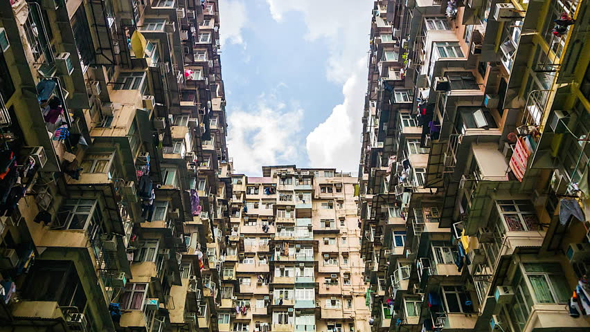 4k. Time lapse of Old Apartment with Moving Cloud in Hong Kong of China