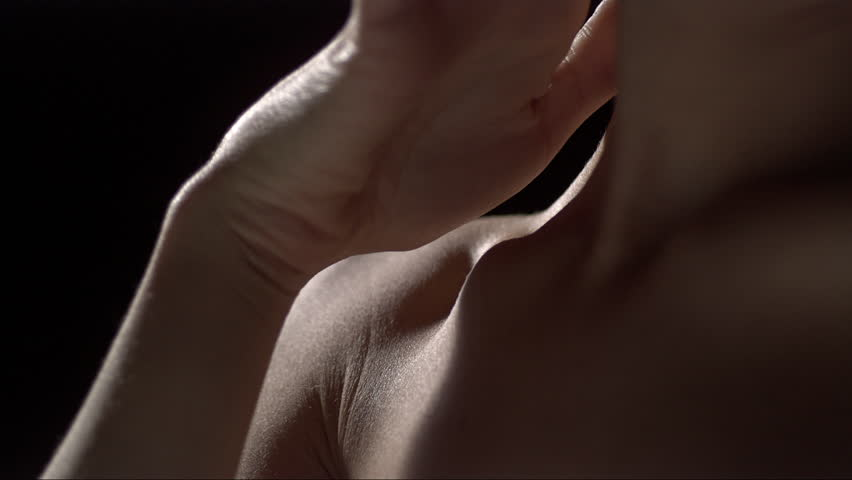 slow motion water drops on a beautiful woman body