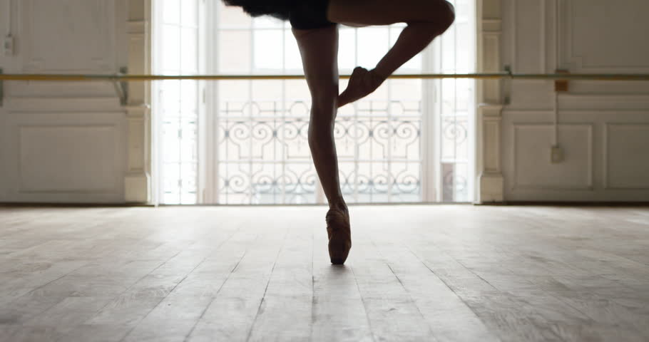 Buenos Aires, Argentina - February 27, 2015: Ballerina performing pirouettes in studio, slow motion