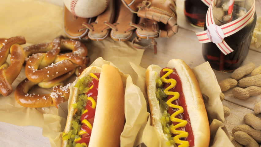 Baseball party food with balls and glove on a wood table. | Shutterstock HD Video #16912414