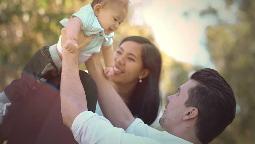 Flying Baby Boy Plays With His Parent at Park | Shutterstock HD Video #16917280