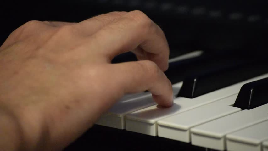 Right-hand playing an arpeggio on piano