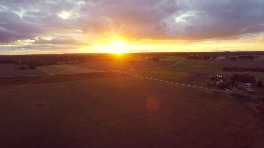 Beautiful sunset at field. Low altitude flight. Aerial footage.   Shutterstock HD Video #16957162