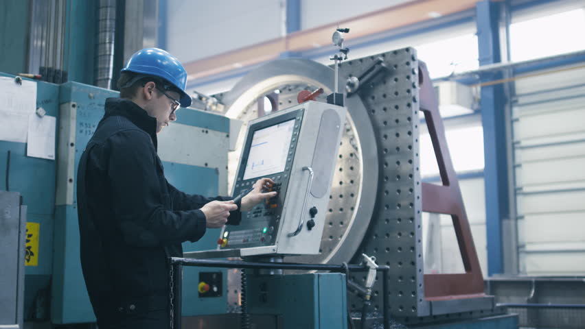 Factory worker is programming a CNC milling machine with a tablet computer. Shot on RED Cinema Camera. | Shutterstock HD Video #16958050