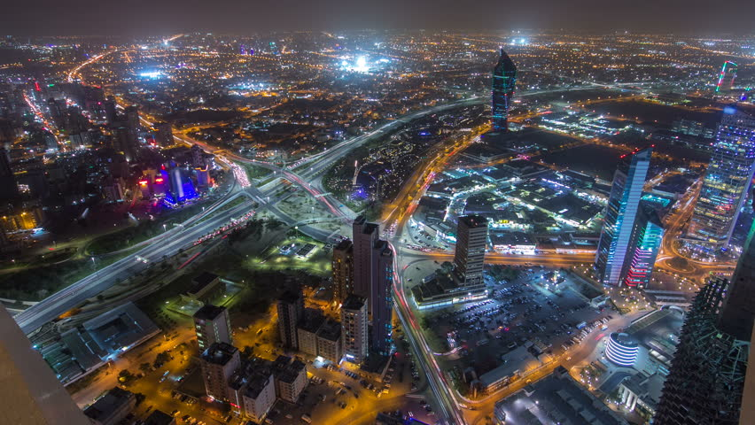 Skyline with Skyscrapers night timelapse in Kuwait City downtown illuminated at dusk. Kuwait City, Middle East | Shutterstock HD Video #16964749