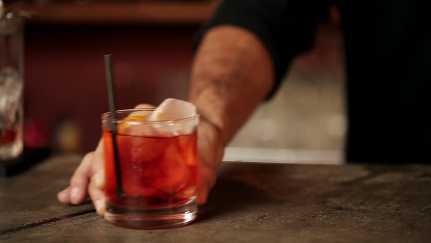 Buenos Aires, Argentina - January 22, 2013: Bartender serving negroni | Shutterstock HD Video #16997827