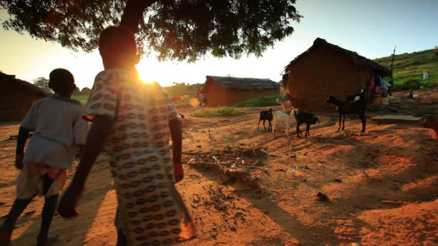 KENYA, AFRICA - CIRCA AUGUST 2010: Kids near a village in Kenya two hours north