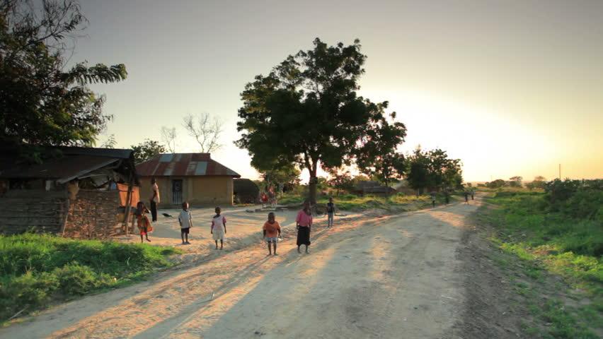 KENYA, AFRICA - CIRCA AUGUST 2010: Shot of children playing in the dirt roads in Kenya, Africa circa August 2010.