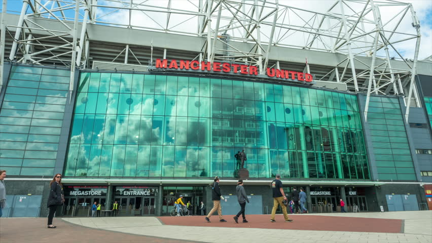 MANCHESTER - MAY 24: Time lapse at infront of Old Trafford football stadium, main stadium of Manchester United football club, with movement of people in Manchester, England, was taken on May 24, 2016.