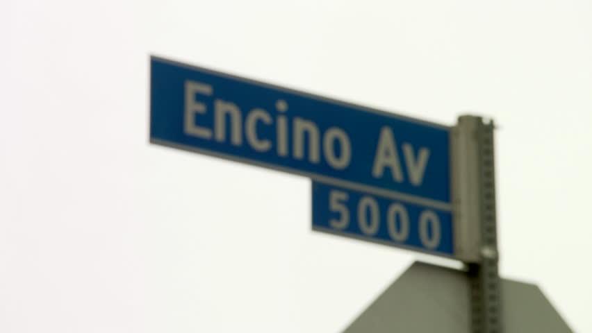 Rack focus Encino Ave. street signs. | Shutterstock HD Video #17028556