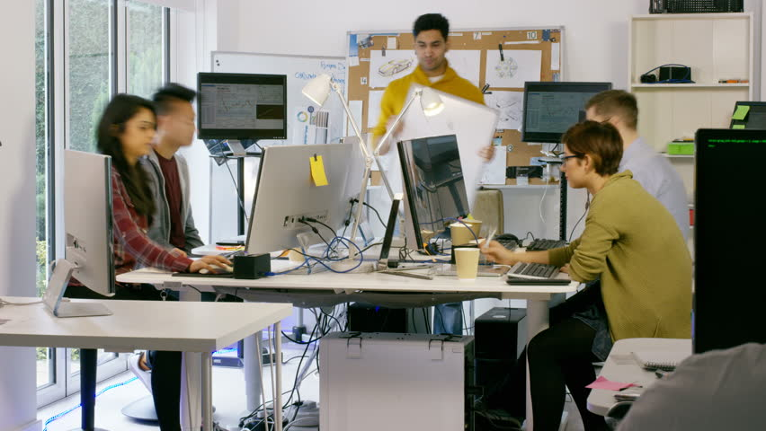 4K Time lapse of young computer experts working in office with lots of computers. Shot on RED Epic. UK - April, 2016 #17049706