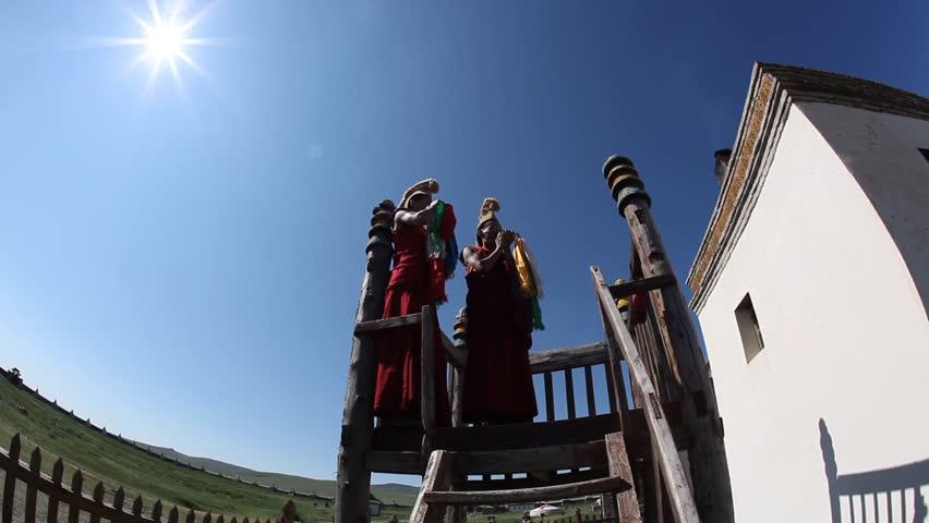 MONGOLIA - JULY 13, 2009: Monks call for prayer at the Erdene Zuu Monastery on July 13, 2009 in Mongolia. | Shutterstock HD Video #1706518