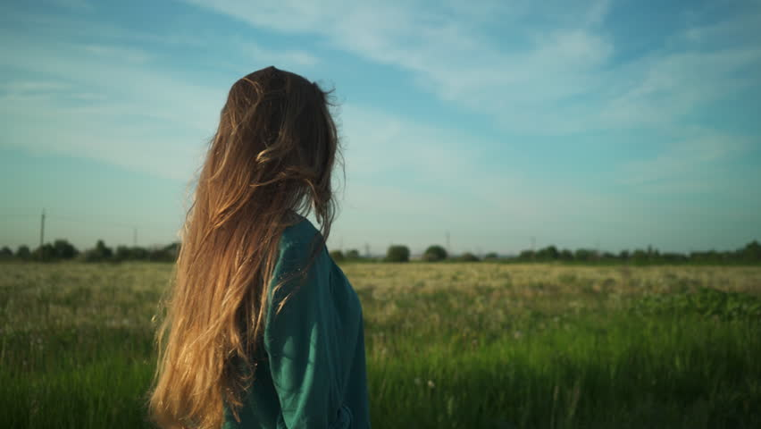 Teen girl walking on old road near fields in sunset to camera shot with stabilizer, uhd prores footage   Shutterstock HD Video #17079835