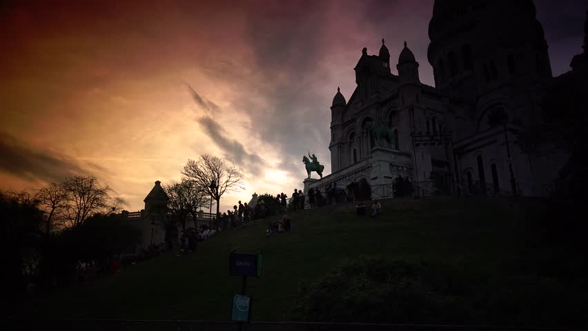 PARIS, FRANCE ,circa May 2016 : spectacular sky at the sunset with the Basilica Sacre Coeur in Montmartre, Paris, ULTRA HD 4k, time lapse   Shutterstock HD Video #17091661