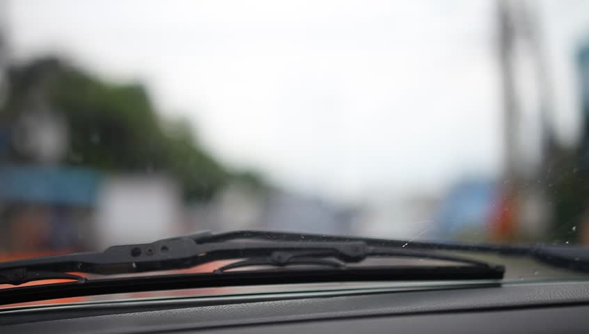 Wiper arm and blurred city traffic background | Shutterstock HD Video #17098786