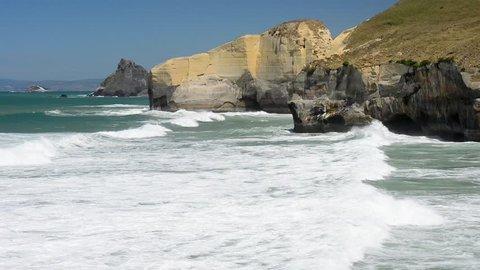 Loop of Pacific ocean waves crushing coast near Dunedin, New Zealand