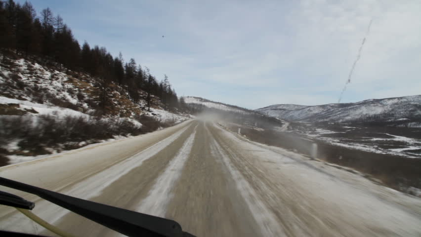 Trucks are traveling on a mountain road. The view from the cab of the truck. Sayan mountains. Siberia. Russian Federation. | Shutterstock HD Video #17123317