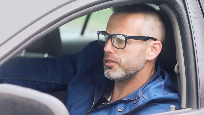 Angry car driver, commuter man in traffic with road rage