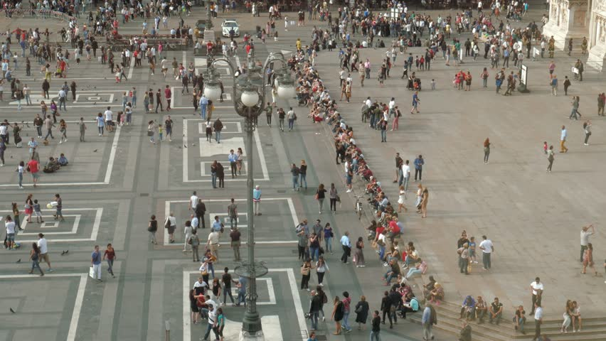 People walking, taking a stroll in Piazza Duomo square, Milan, Italy #17166397