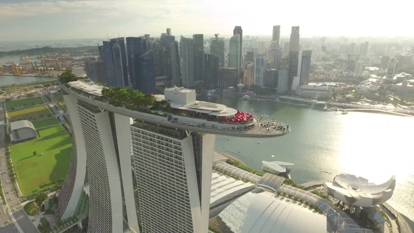 SINGAPORE, MAY 2016: Travelling aerial shot of Marina Bay Sands with Singapore City Skyline as background - May 2016 (Singapore) #17167999
