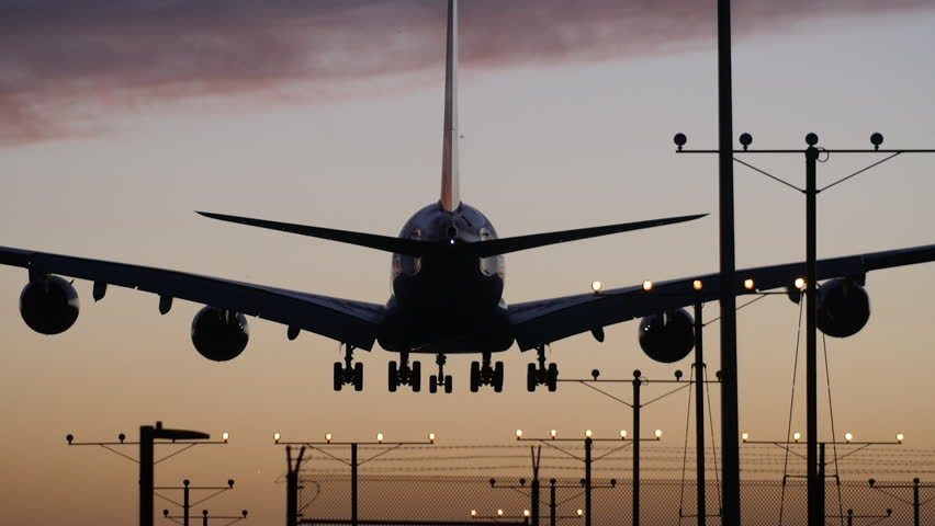 A Dramatic Shot of a 747 Landing at Sunset in Slow Motion.